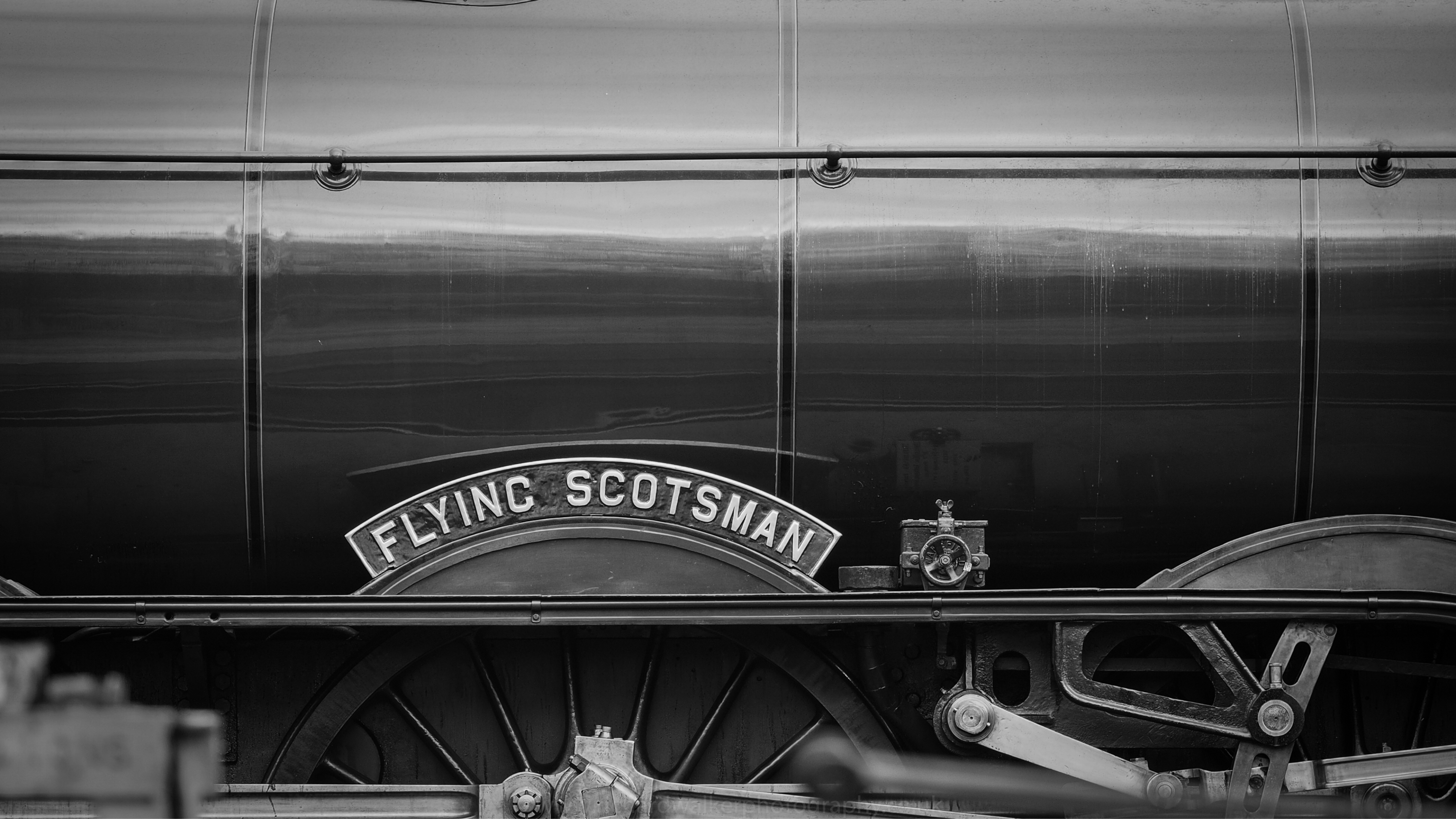 The Flying Scotsman nameplate in black and white