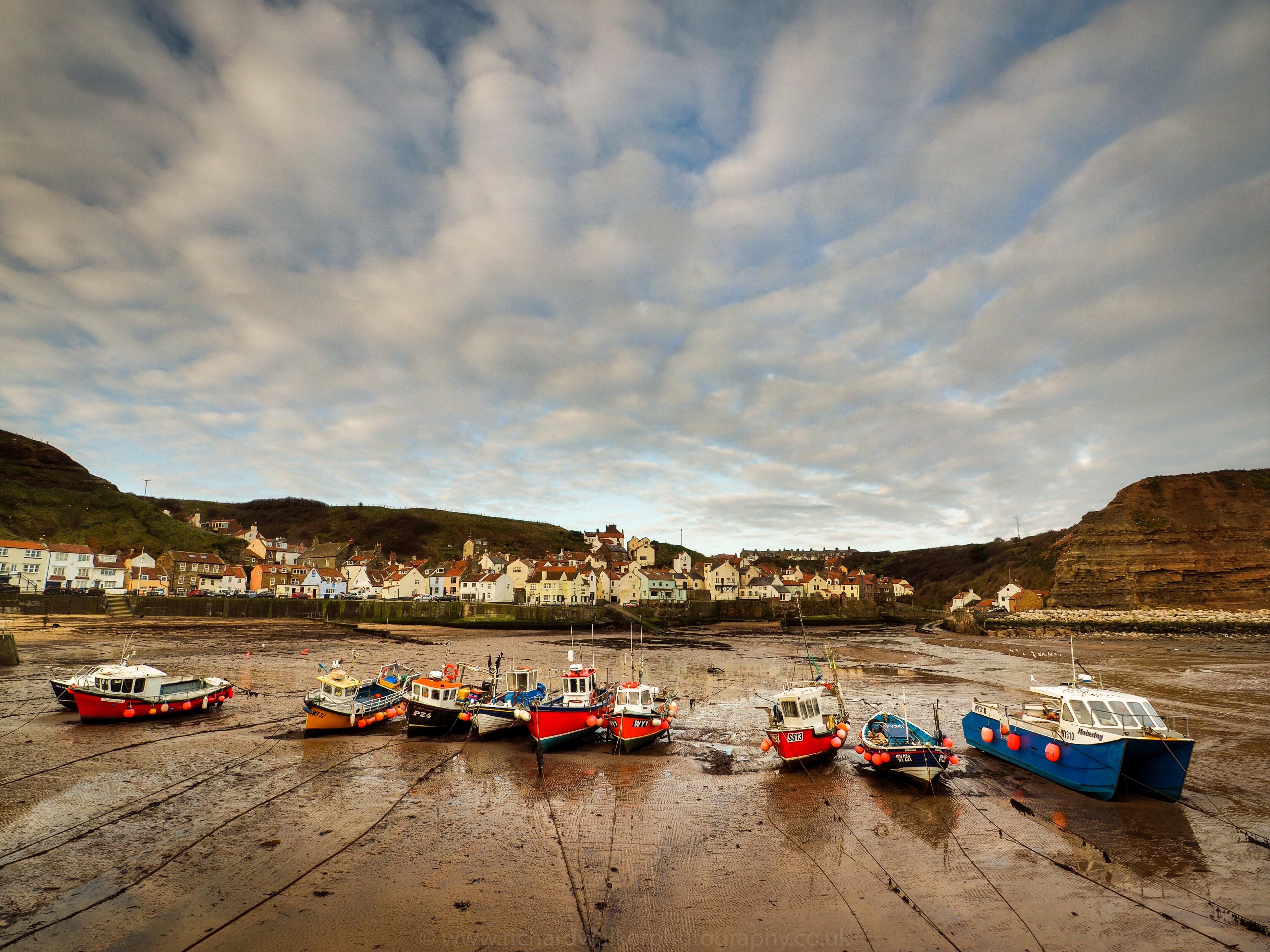 A row of boats in Staithes Harbour in North Yorkshire