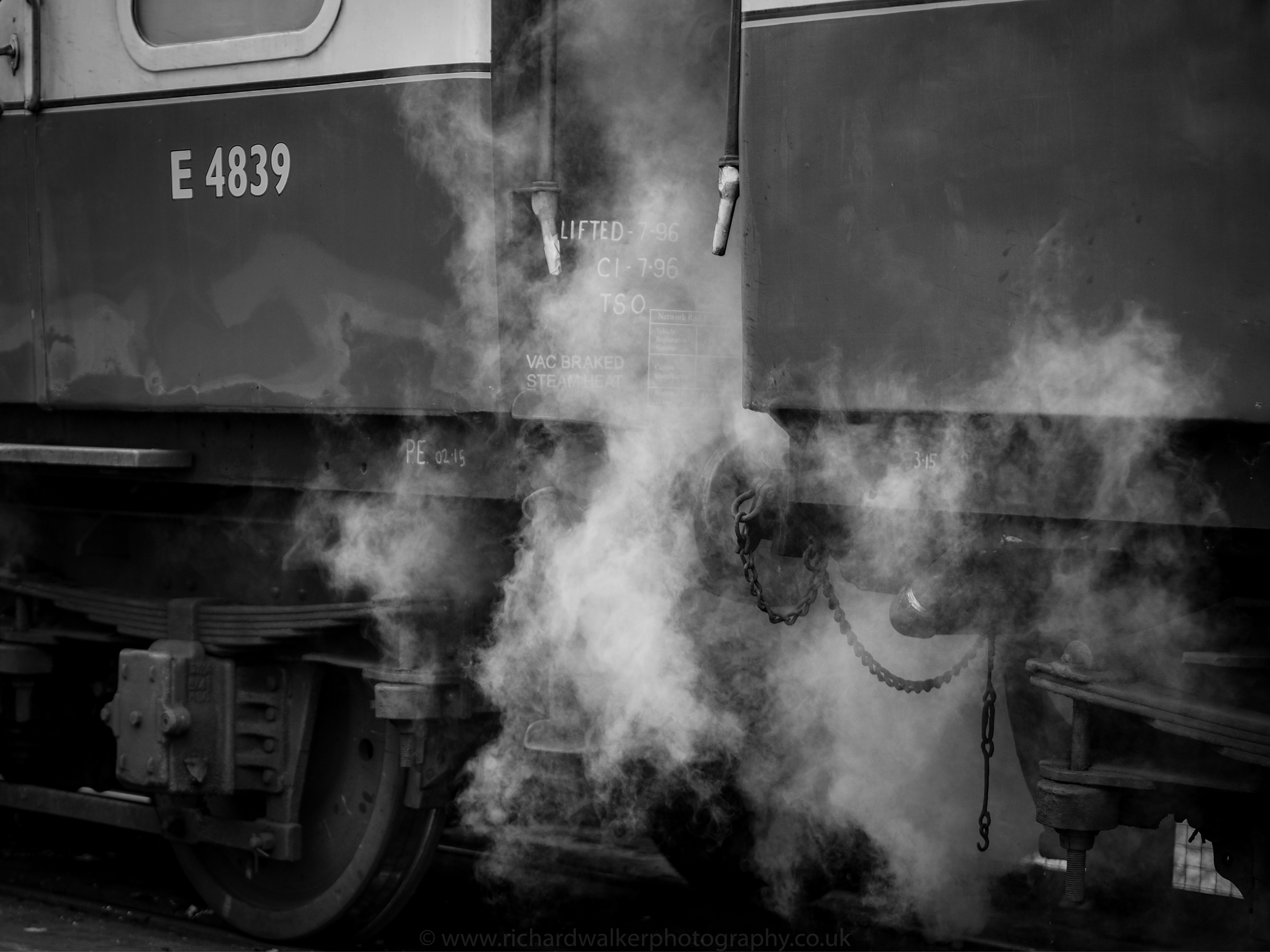 Steam pours from between the carriages of the Flying Scotsman at Pickering Station
